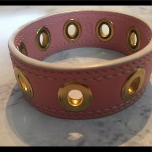 Coach pale pink leather cuff with gold grommets